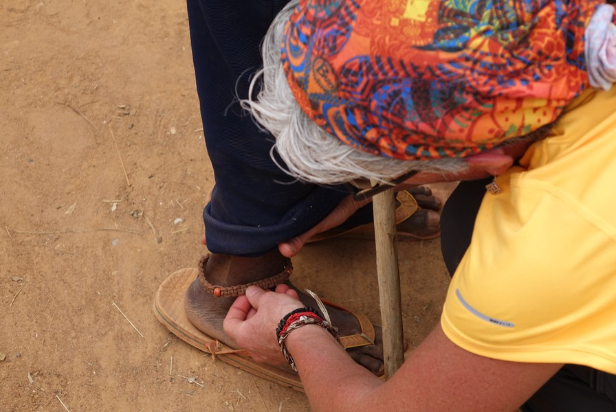 Congo photo amy putting anklet on person